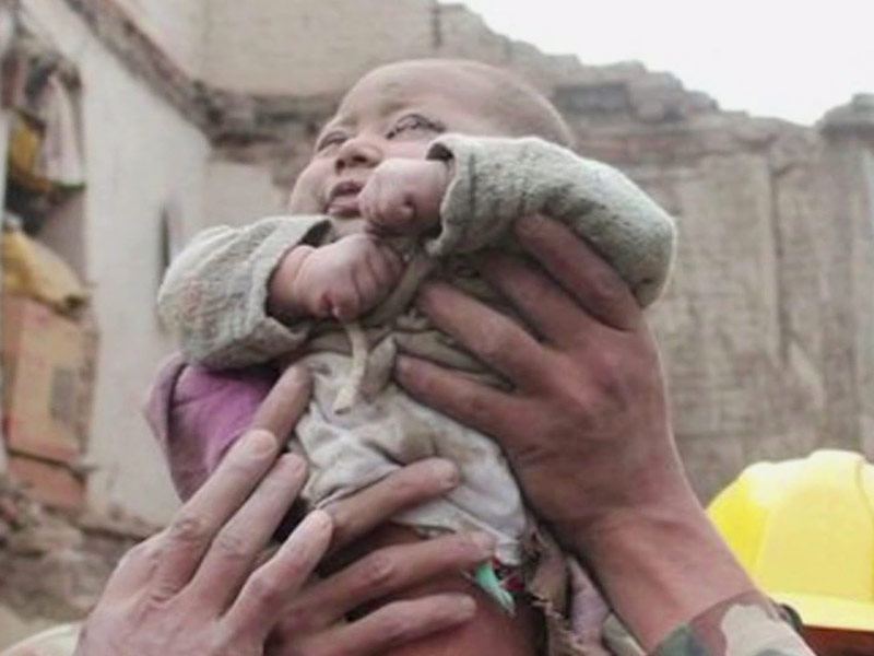 no sort of miracle; a baby survives the devastation
