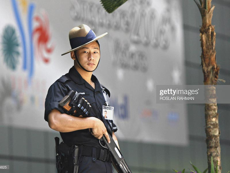Singapore Gurkha Police with his official service kukri