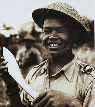 Gurkha soldier showing khukuri with smiles